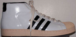 adidas Promodel Original high-top basketball shoe (white patent leather, black stripe and trims, beige outsole)
