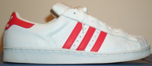 adidas Superstar basketball shoe, white with red trim