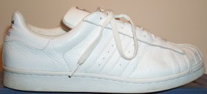 adidas Superstar basketball shoe, white leather with white stripes and trim