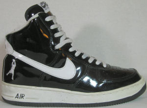 Nike Air Force 1 retro basketball shoe: black patent leather with white SWOOSH
