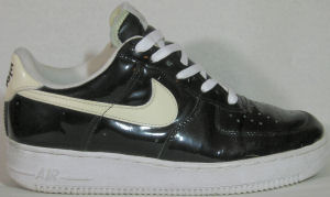 Nike Air Force I low-top, black patent leather with white SWOOSH