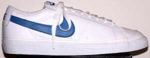 Nike Bruin low-top basketball shoe in white leather with blue SWOOSH