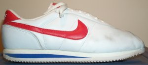 Nike Cortez sneaker, white leather, red SWOOSH, blue trim