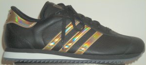 The adidas Country Ripple sneaker in black with shiny gold stripes
