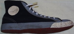 1948 Converse high-top gym shoes: black uppers, gray fabric trim, white rubber trim, red sole)