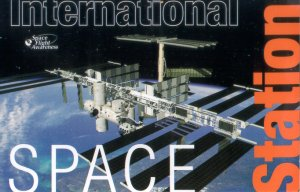 "International Space Station ""Assembly Complete"" picture with text overlays"