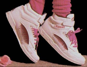 White and pink high-top LA Gear sneakers and pink scrunch socks