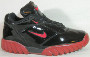 Nike Air Live Wire shoe in black with red SWOOSH and trim