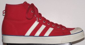 Red adidas Nizza retro basketball shoe with white stripes