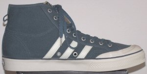 adidas Nizza high-tops in blue with white stripes and metal Buick Ventiports between the stripes