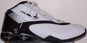 Nike Women's Shox Status basketball shoe: white with black SWOOSH, black and silver trim