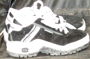 Black Skechers sneakers with white trim