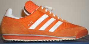 The adidas SL-72 in orange with white stripes and trim