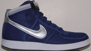 Nike Vandal high-top shoe: blue with gray and gold ankle strap and glossy silver and white SWOOSH