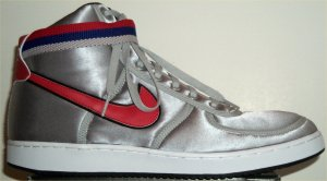 Nike Vandal Supreme high-top shoe: metallic silver with red and black SWOOSH, (red, black, and gray) ankle strap